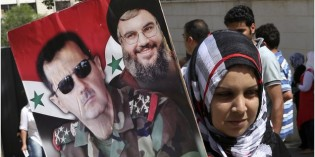 Syrians Vote Amidst Battle; Assad Poised to Be Back