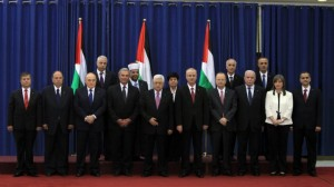 AFP (Palestinian president Mahmoud Abbas (C) poses for a picture with the members of the new Palestinian unity government)
