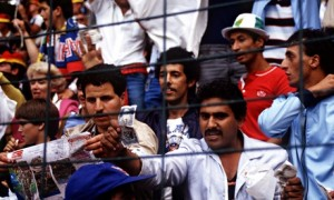 An Algeria fan waves a bank note to show his disgust at West Germany's 1-0 win against Austria in the 1982 World Cup.