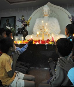 Boys in prayer before a Buddha image at a conversion programme orgainsed by the Karnataka Dalitha Sangharsha Samiti at Ambedkar Bhavan in Bangalore in October 2008. Photo:The Hindu Archives