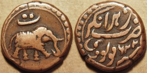 Tipu Sultan (1782-1799) AE Paisa, Nagar, AM 1226 Weight: 11.26 gm. Diameter: 23 mm Die axis: 12 o'clock Caparisoned elephant walking right, Persian letter Te above Persian legend stating mint Nagar and AM date 1226 (=1797 CE)